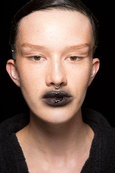 Gareth Pugh's spring/ summer 2017 makeup look was dark and gothic. This makeup look works best with bare skin.