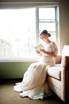 Bride reading a card from the groom
