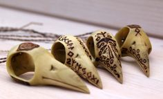 A collection of carved bird skulls. Some featuring Futhark runes