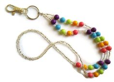 beaded lanyard, rainbow lanyard, badge holder, key strap, key lanyard, teacher lanyard, flash drive holder, librarian lanyard, keyring by MissyRoseStudios on Etsy https://www.etsy.com/listing/259477095/beaded-lanyard-rainbow-lanyard-badge
