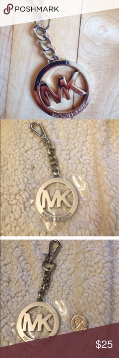 Authentic Silver Michael Kors Hang Tag Practically new, came off of a purse I recent bought from MK. 5.5 in diameter. Michael Kors Accessories