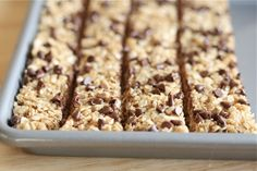 "Quick easy healthy snack- ""No Bake healthy chocolate chip granola bars. Holy Cow, these are great! The kids love them, they take only 5 min to make, and they are yummy! Yummy Snacks, Delicious Desserts, Snack Recipes, Dessert Recipes, Cooking Recipes, Yummy Food, Kid Snacks, School Snacks, Easy Recipes"