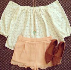 White top and pinkish shorts with brown flats