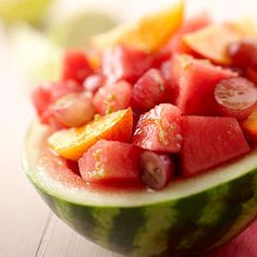 Stuffed Baby Watermelon Watermelon will never taste better than in this lime- and honey-tossed medley of melon, peach, and grapes.