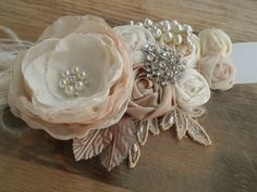 Briann... Bridal Sash in Champagne, Ivory creams, Nude and Bridal White Rosette Sash with beautiful pearl, on Etsy, $99.95
