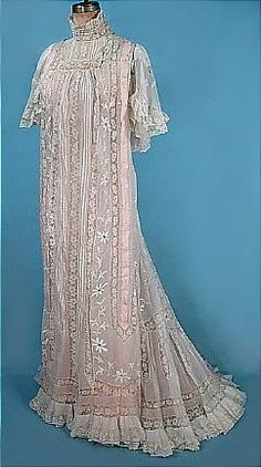 White Lawn Trained Dressing Gown With High Neck, Full Sleeves, Embroidered With Lace And Pink Ribbon  c.1900