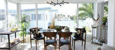 Create a dining space you'll love - whether it's small or sprawling - featuring elements of mid-century, global, modern, and glam styles. Interior designer Taniya Nayak mixes favorite looks in a neutral color palette highlighted by golden accents.