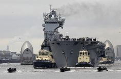 HMS Ocean - Royal Navy Helicopter Carrier comes up the Thames to help keep London secure during the 2012 Olympics.  Is it a little over the top?