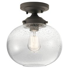 The simple and elegant Avery Semi Flush Ceiling Light features a Clear Seedy glass globe diffuser with an Olde Bronze or Brushed Nickel finish. One 100 watt max 120 volt medium base bulb is required, but not included. 9.75 inch width x 10.75 inch height. UL listed.