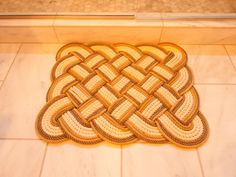 Three different kinds of rope were used to hand-weave this Alaska Rug Co. bathmat in a stonk knot design for the master bathroom of DIY Network's Blog Cabin 2015.