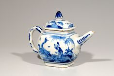 18th century Dutch Delft blue and white chinoiserie teapot, body painted with a Chinese figure in front of a pine tree feeding ducks,  the spout and loop handle with scroll motifs and dots, lid decorated with floral sprigs and rock work, cone shape knob, c. 1710, tin-glazed ceramic, Holland/The Netherlands