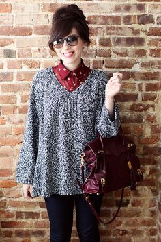 Pop a silky shirt underneath an oversized sweater to take your look from frumpy to fab!