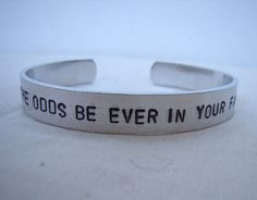May the odds be ever in your favor hunger games quote aluminum cuff