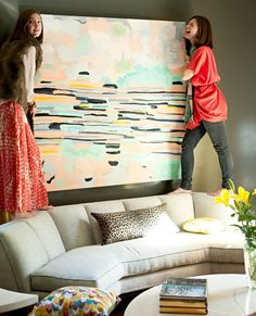 I love this picture for the picture within, and for the colors, and for what is occurring. I can relate in many ways, there have been many a time I stand on furniture in the name of decorating