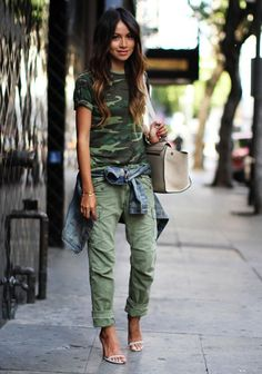 Dress up a casual camo style with a pair of heeled sandals and matching handbag. Break up the colors in your outfit with a denim jacket wrapped around your waist.