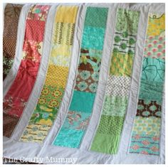 Simple charm square quilt with sashing and two borders  (via The Crafty Mummy)