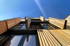Combinatie balkonafscheiding en zonnewering Sint-Martinus by LensAss architecten , via Behance