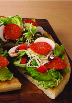 Italian Pizza Bowl Salad – Want to improve your salad game? Make it a pizza when you spoon fresh greens and pizza toppings onto warmed pizza crust wedges.