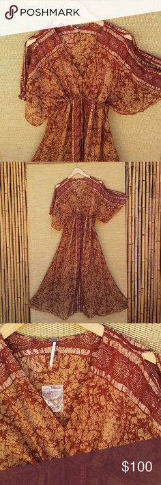"""Free People Boho Style Dress NWOT! Free People Boho Style Dress NWT! This dress has a v-neck and front tie for a better fit, wide split seam sleeves, A line skirt, length approx 50"""" from shoulder, 18"""" pit2pit, 100% rayon, fully lined to knee, hand wash cold. Purchased at outlet black line through FP tag, no hang tag but does have extra button attatched. Very unique colors and beautiful boho print! Free People Dresses"""