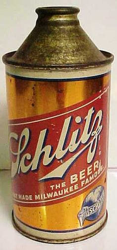 """SCHILTZ BEER CONE TOP BEER CAN. Measures 5 1/2"""" in height. 12 fluid ounce tin. Gold litho is in very decent condition with just tiny nicks scratches and dents. (Internal  Revenue Tax Paid) printed on side. Nice example. C 1940's."""