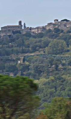 Rome to Florence on High Speed Train - a view of a Tuscan hill town through the window.