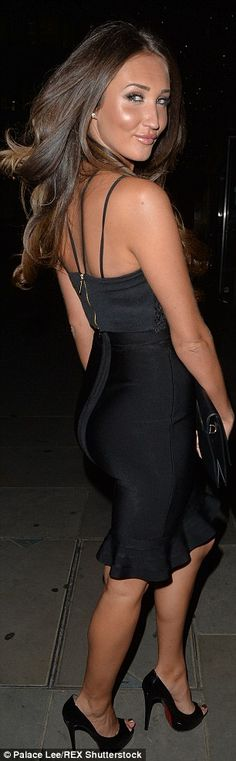 No pain, no gain: The brunette flaunted her slim pins in a frilled-hem little black dress ...