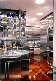 stainless steel cabinets  blue bahia granite countertops Brazilian cherry wood floors