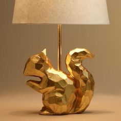 A lively accent for any animal lover, our stunning squirrel desk lamp boasts a geometric construction in bright gold, adding modern style and light to any room.