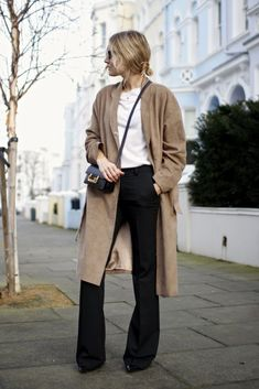 Black trousers, suede trench, white top