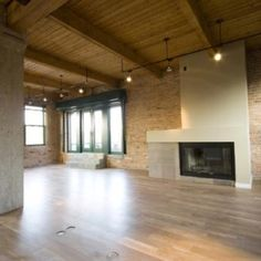 I love timber lofts. Always wanted to live in one...adore the rustic walls and timber ceilings of this chicago loft