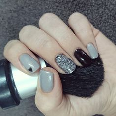 Grey and black nails with silver glitter and heart