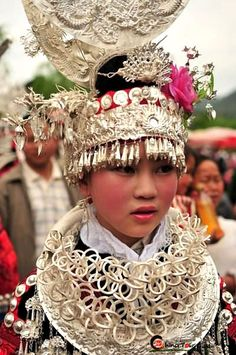 The Miao are very famous for their silverware, and come festival time you'll see the younger girls literally weighed down by their giant, elaborate headdresses and row upon row of necklaces and bangles.