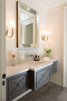 wall-mount vanity in dark stain with contrasting light walls and countertops -