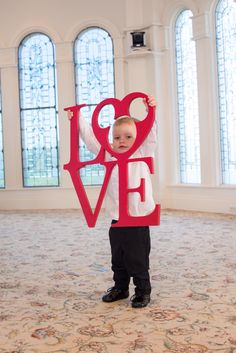 Posing at Disney's Wedding Pavilion. How adorable is this little groomsman? Love!