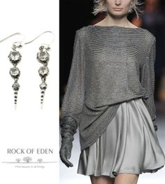 Nothing says holidays like silver and sparkles.  Antique crystal spike earrings from rockofeden.com complete this look by Duyos.  #spike #antique #holidayparty #earrings #jewelry #christmas
