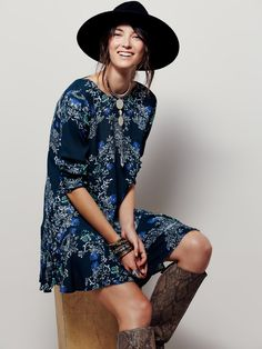 Smooth Talker Floral Print Tunic | Floral printed crepe tunic with ruffled hem and low V-back with strap detail. Hip pockets.