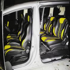 car auto silver with yellow and black and grey interior