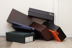 Empty shoe boxes on the floor by the halldoor.
