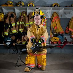 Firefighter Photography | Vince Brasco, the world's smallest firefighter, poses for a picture.  I love this