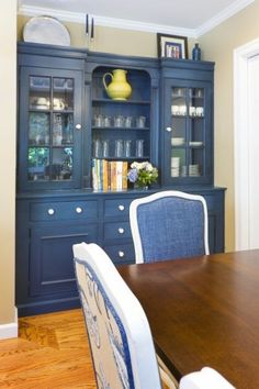 traditional dining room by Amoroso Design - blueberry cabinetry. I'd like this in red.
