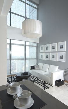 8 larges square frames and a big fixture to decorate a high ceiling living room | Modern Luxury