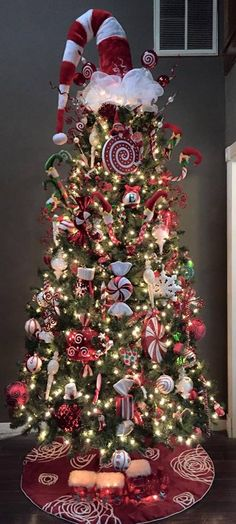 Beautiful decorated Christmas tree. Santa hat topper, decomesh, elf feet, red & white candy - 2015 by VW