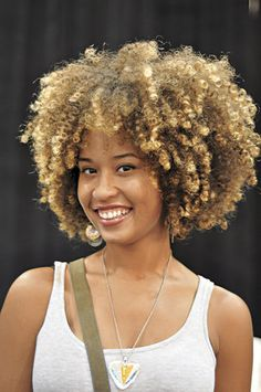 Beautiful natural curly fro. I love the hair color and the highlights.
