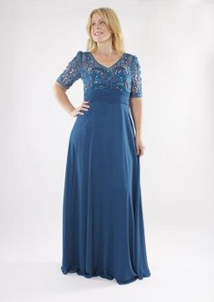 The top of this dress is so glamorous and the loose skirt is flattering!