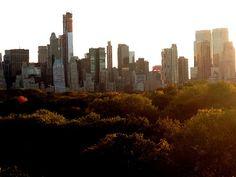 New York City skyline from rooftop of Metropolitan Museum of Art, sunset. ART GIRL