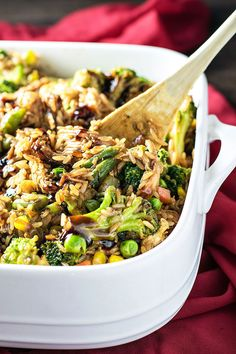 The best of Chinese takeout baked in a casserole dish with assorted veggies and fried rice.