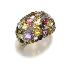 Gem set bangle, 1960s - The hinged bangle set with multi-coloured mixed-cut gemstones, including: amethysts, citrines, garnets and sapphires, inner circumference approximately 160mm.