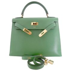 Vintage Hermes Kelly Vert Clair 29 Sellier BagYear 1997 = A inside a square stamp. Gold hardware with shoulderstrap.Initials B.Bstamped on the outside. Leather is Courchevel.Please look at all the photos. The 4 corners aredamaged. The bag is 20 years old so it hasscratches.The inside hasscratches but no smells, 2 pockets.Comes with the shoulder strap.There is a lock but no keys or clochette so it is not a full set. No dustbag or box.Length 11.5 inches = 29 cmDepth 4.5 inche...