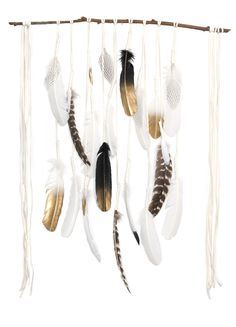 "Santa Ana wall hanging White deerskin suede and hand wrapped feathers are draped over an eucalyptus branch. Assorted feathers including natural and hand painted. Branch measures approximately 30"" wide"