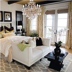White, Black and Gray Bedroom with Chandelier.